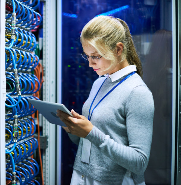 Engineer monitoring climate controls data center.